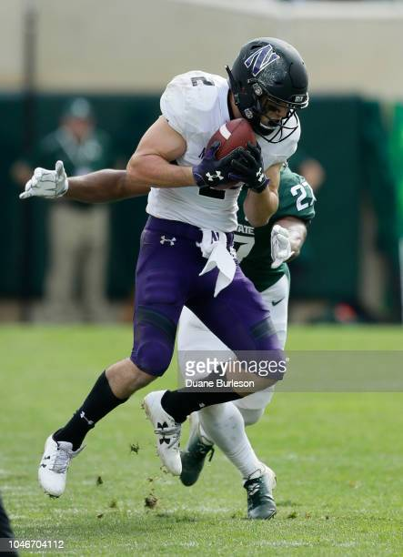 Wide receiver Flynn Nagel of the Northwestern Wildcats makes a reception while being covered by safety Khari Willis of the Michigan State Spartans...