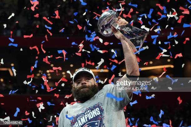 TOPSHOT Wide receiver for the New England Patriots Julian Edelman holds the trophy as he celebrates Super Bowl LIII against the Los Angeles Rams at...