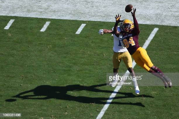 Wide receiver Frank Darby of the Arizona State Sun Devils attempts to make a catch in front of defensive back Darnay Holmes of the UCLA Bruins in the...