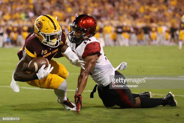 Wide receiver Frank Darby of the Arizona State Sun Devils catches a 42 yard reception against safety Tariq Thompson of the San Diego State Aztecs...