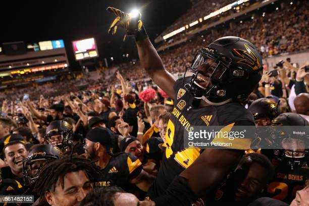 Wide receiver Frank Darby of the Arizona State Sun Devils celebrates with teammates on the field after defeating the Washington Huskies in the...