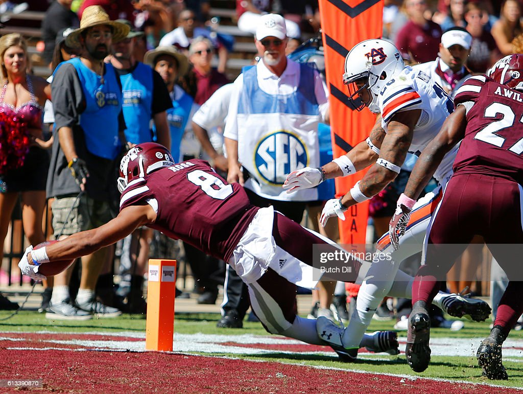 Wide receiver Fred Ross #8 of the Mississippi State Bulldogs dives in for a touchdown as defensive back Tray Matthews #28 of the Auburn Tigers tries to push him out of bounds during the second half of an NCAA college football game on October 8, 2016 in Starkville, Mississippi. Auburn won 38-14.
