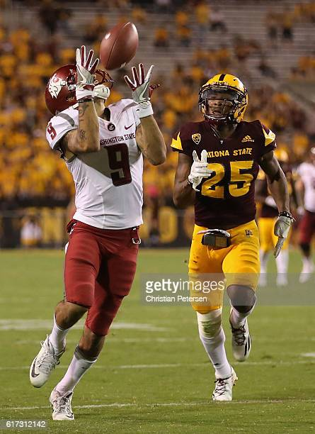 Wide receiver Gabe Marks of the Washington State Cougars catches a 52 yard touchdown reception past defensive back Kareem Orr of the Arizona State...