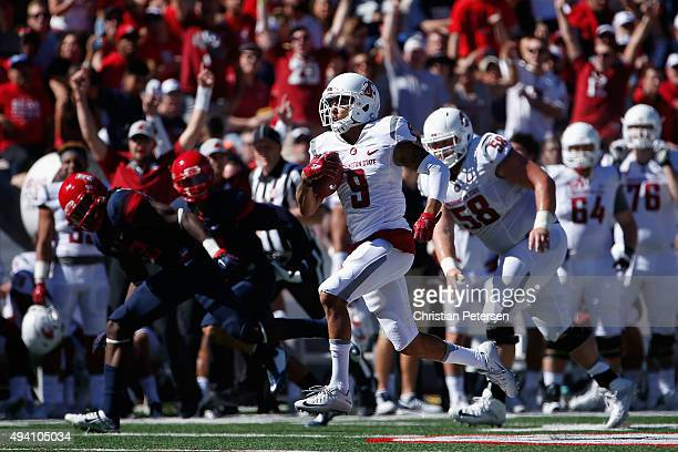 Wide receiver Gabe Marks of the Washington State Cougars runs with the football enroute to scoring a 43 yard touchdown reception against the Arizona...