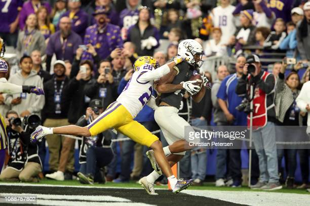 Wide receiver Gabriel Davis of the UCF Knights catches a 32yard touchdown pass over cornerback Mannie Netherly of the LSU Tigers during the second...