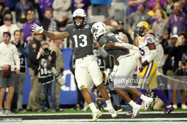 Wide receiver Gabriel Davis reacts with teammate wide receiver Dredrick Snelson of the UCF Knights after scoring a 32yard touchdown during the second...