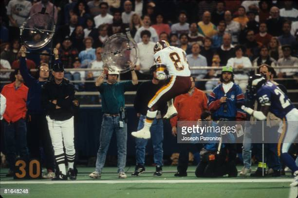 Wide receiver Gary Clark of the Washington Redskins catches a pass against the Minnesota Vikings in the 1992 NFC Wildcard Game at the Metrodome on...