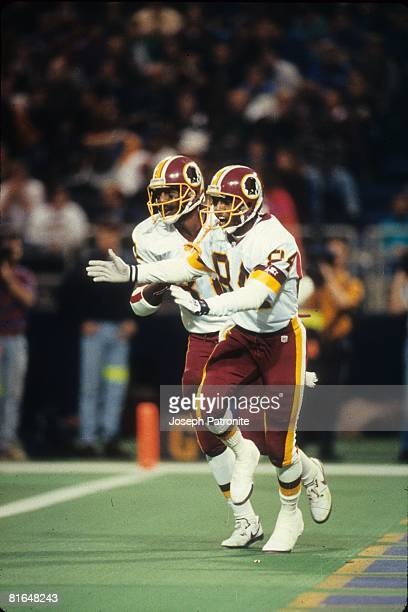 Wide receiver Gary Clark of the Washington Redskins celebrates a 24yard scoring reception against the Minnesota Vikings in the 1992 NFC Wildcard Game...