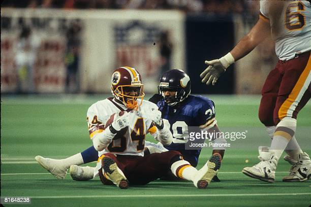 Wide receiver Gary Clark of the Washington Redskins smiles after making a reception in front of cornerback Carl Lee of the Minnesota Vikings in the...