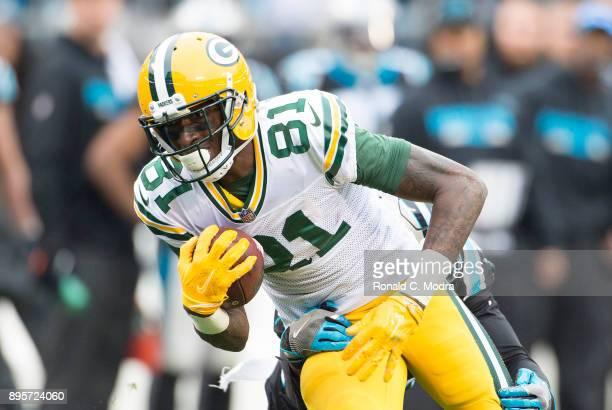 Wide receiver Geronimo Allison of the Green Bay Packers carries the ball against the Carolina Panthers during a NFL game at Bank of America Stadium...
