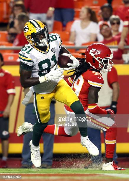Wide receiver Geronimo Allison of the Green Bay Packers catches a pass for a touchdown as defensive back Tremon Smith of the Kansas City Chiefs...