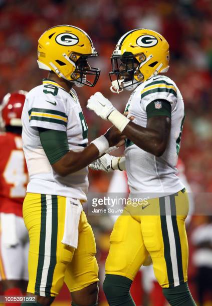 Wide receiver Geronimo Allison of the Green Bay Packers is congratulated by quarterback DeShone Kizer after catching a pass for a touchdown during...