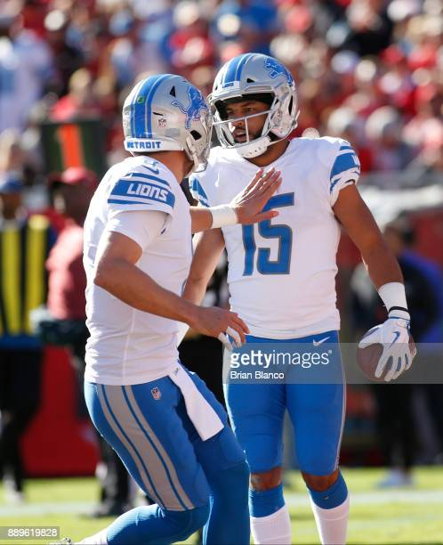 Wide receiver Golden Tate of the Detroit Lions celebrates with quarterback Matthew Stafford after scoring a touchdown during the second quarter of an...