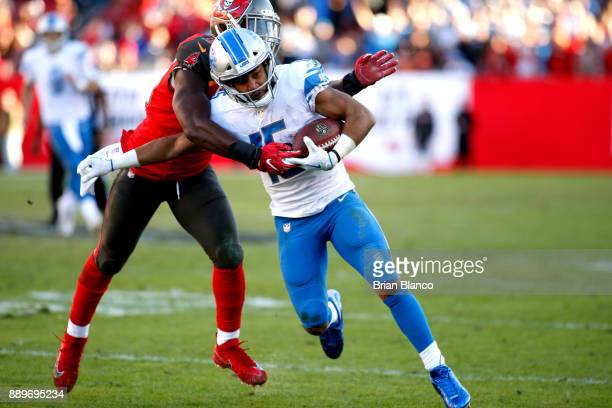 Wide receiver Golden Tate of the Detroit Lions is stopped by outside linebacker Lavonte David of the Tampa Bay Buccaneers during a carry in the...