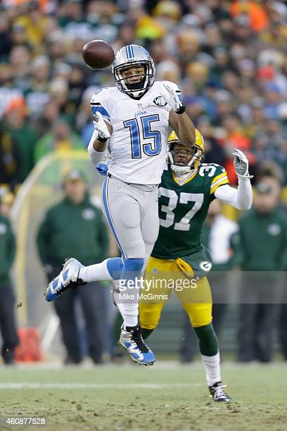 Wide receiver Golden Tate of the Detroit Lions receives the football against cornerback Sam Shields of the Green Bay Packers for a first down in the...