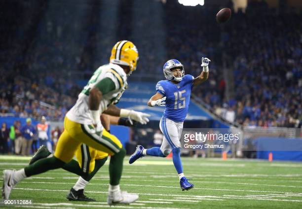 Wide receiver Golden Tate of the Detroit Lions throws a two point conversion pass to quarterback Matthew Stafford of the Detroit Lions against the...