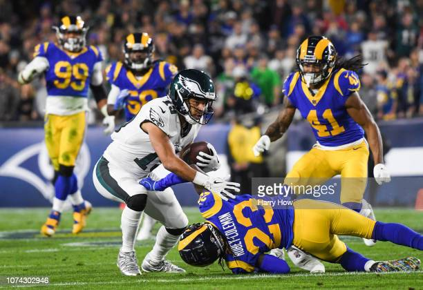 Wide receiver Golden Tate of the Philadelphia Eagles is stopped by defensive back Nickell Robey-Coleman of the Los Angeles Rams after his catch in...
