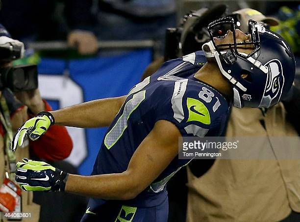 Wide receiver Golden Tate of the Seattle Seahawks celebrates by eating a Skittles after running back Marshawn Lynch scores a 40yard touchdown against...