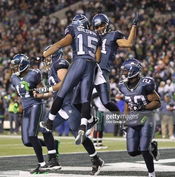 Wide receiver Golden Tate of the Seattle Seahawks celebrates with Doug Baldwin after scoring a touchdown against the Philadelphia Eagles at...