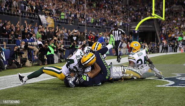 Wide receiver Golden Tate of the Seattle Seahawks makes a catch in the end zone to defeat the Green Bay Packers 1412 on a controversial call by the...