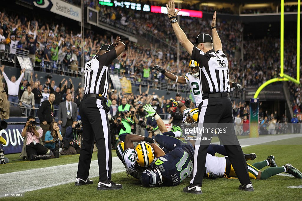Wide receiver Golden Tate #81 of the Seattle Seahawks makes a catch in the end zone to defeat the Green Bay Packers on a controversial call by the officials at CenturyLink Field on September 24, 2012 in Seattle, Washington.