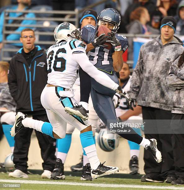 Wide receiver Golden Tate of the Seattle Seahawks makes a catch out of bounds against Robert McClain of the Carolina Panthers at Qwest Field on...