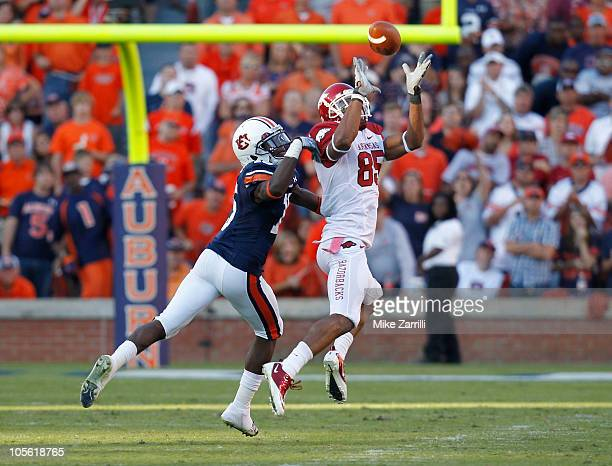 Wide receiver Greg Childs of the Arkansas Razorbacks catches a pass behind defensive back Neiko Thorpe of the Auburn Tigers during the game at...