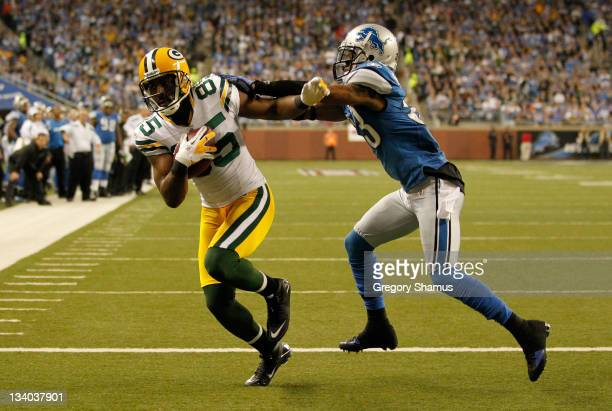 Wide receiver Greg Jennings of the Green Bay Packers catches a threeyard touchdown pass against Brandon McDonald of the Detroit Lions in the second...