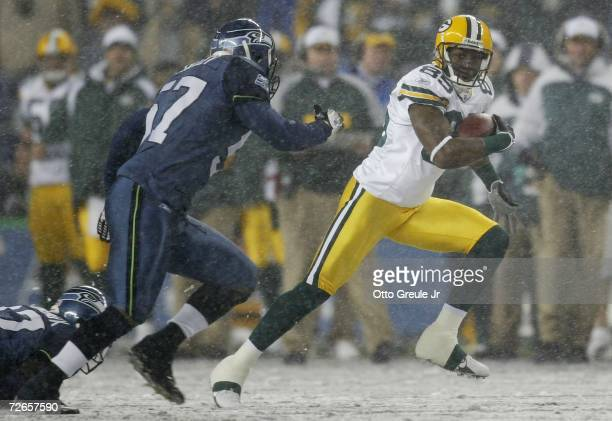 Wide receiver Greg Jennings of the Green Bay Packers rushes against the Seattle Seahawks on November 27 2006 at Qwest Field in Seattle Washington