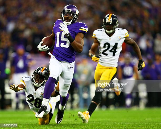 Wide receiver Greg Jennings of the Minnesota Vikings outpaces cornerback Cortez Allen of the Pittsburgh and cornerback Ike Taylor of the Pittsburgh...