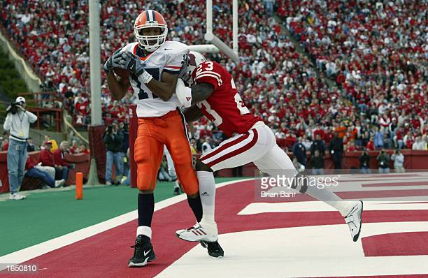 Wide receiver Greg Lewis of the Illinois Fighting Illini pulls down a touchdown pass against defensive back BJ Tucker of the Wisconsin Badgers in the...