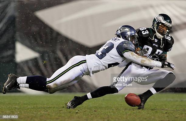 Wide receiver Greg Lewis of the Philadelphia Eagles is blocked by center back Marcus Trufant of the Seattle Seahawks during the second quarter of the...
