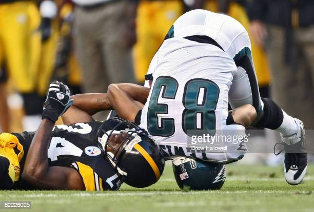 Wide Receiver Greg Lewis of the Philadelphia Eagles lands on his head after getting hit by cornerback Ike Taylor of the Pittsburgh Steelers on August...