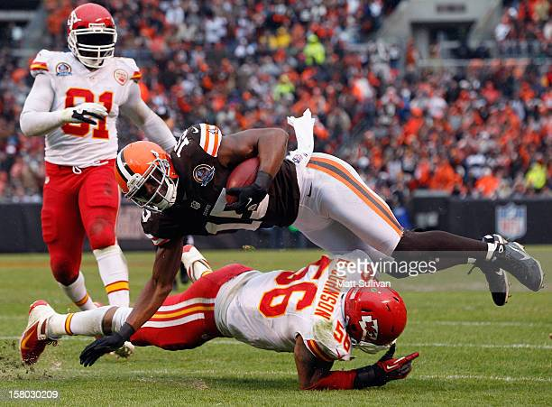 Wide receiver Greg Little of the Cleveland Browns dives for extra yardage over linebacker Derrick Johnson of the Kansas City Chiefs as linebacker...