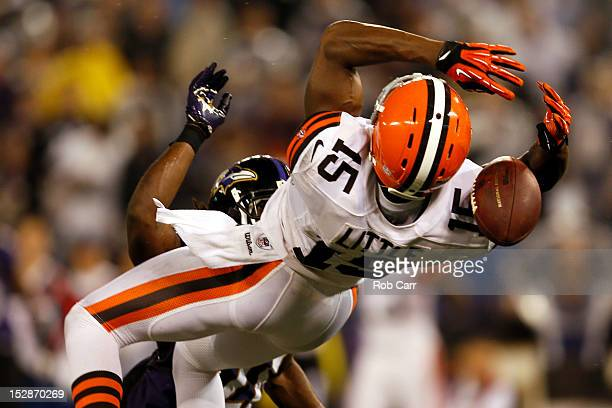 Wide receiver Greg Little of the Cleveland Browns drops the pass in the fourth quarter against cornerback Lardarius Webb of the Baltimore Ravens...