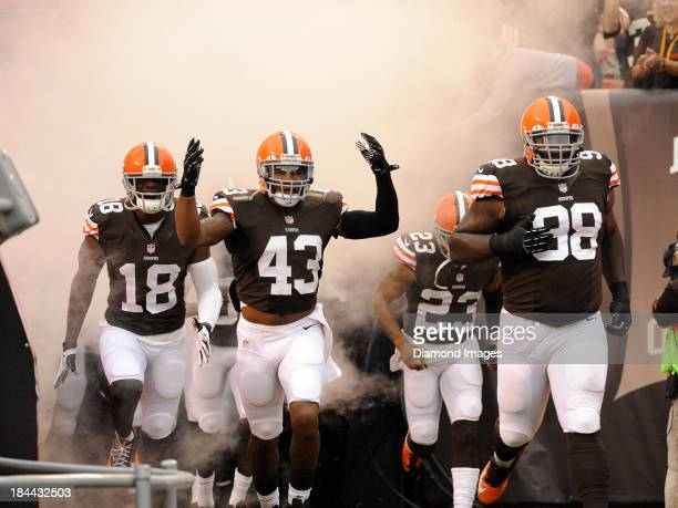 Wide receiver Greg Little safety TJ Ward cornerback Joe Haden and defensive tackle Phil Taylor of the Cleveland Browns runs onto the field after...