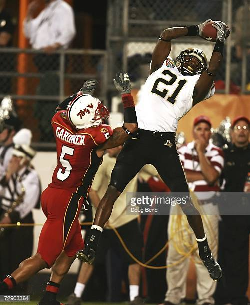 Wide receiver Greg Orton of the Purdue Boilermakers makes a touchdown catch in the second quarter over cornerback Isaiah Gardner of the Maryland...