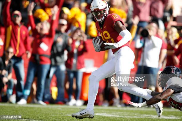 Wide receiver Hakeem Butler of the Iowa State Cyclones breaks away from defensive back Damarcus Fields of the Texas Tech Red Raiders to score a...