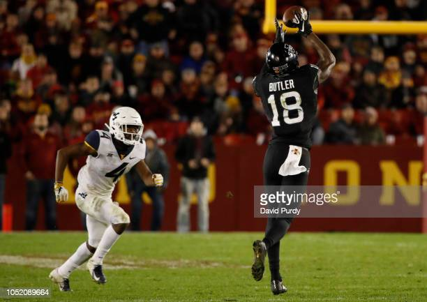 Wide receiver Hakeem Butler of the Iowa State Cyclones catches a pass as safety Josh Norwood of the West Virginia Mountaineers defends in the second...