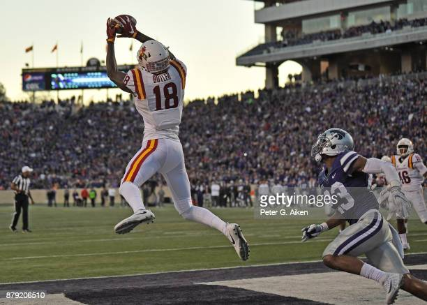 Wide receiver Hakeem Butler of the Iowa State Cyclones catches a touchdown pass against defensive back Cre Moore of the Kansas State Wildcats during...