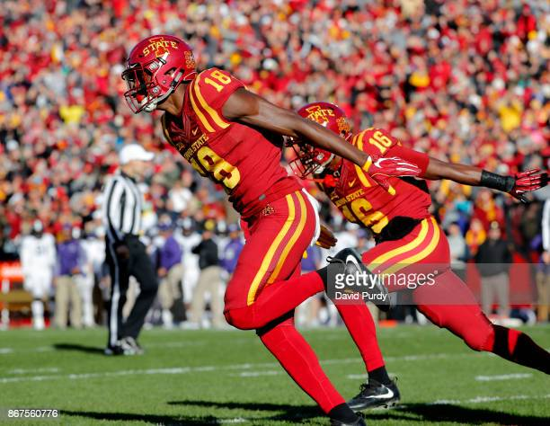 Wide receiver Hakeem Butler of the Iowa State Cyclones celebrates with teammate wide receiver Marchie Murdock of the Iowa State Cyclones after...