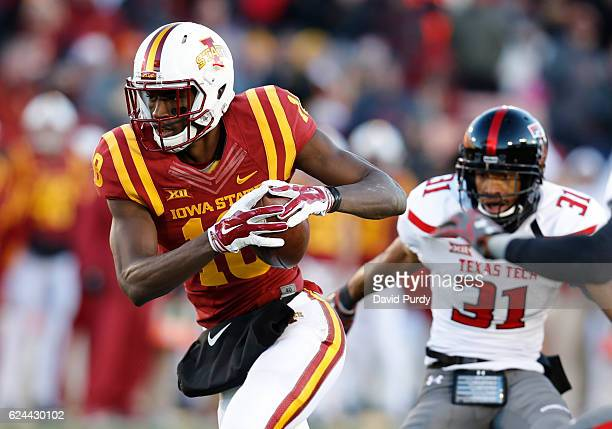 Wide receiver Hakeem Butler of the Iowa State Cyclones drives the ball past defensive back Justis Nelson of the Texas Tech Red Raiders for a...