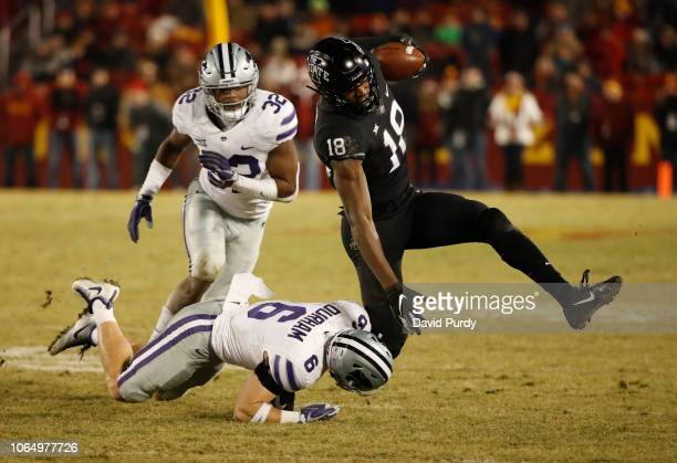 Wide receiver Hakeem Butler of the Iowa State Cyclones is tackled by defensive back Johnathan Durham of the Kansas State Wildcats while linebacker...