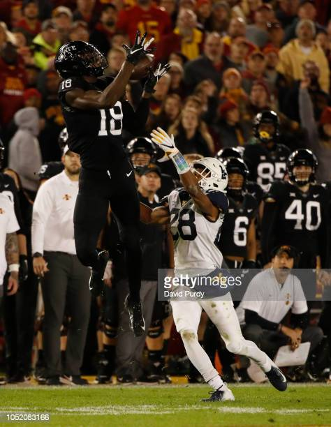 Wide receiver Hakeem Butler of the Iowa State Cyclones pulls in a reception as linebacker Rashon Lusane of the West Virginia Mountaineers blocks in...