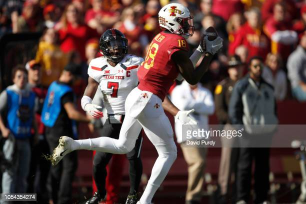 Wide receiver Hakeem Butler of the Iowa State Cyclones pulls in a pass as defensive back Jah'Shawn Johnson of the Texas Tech Red Raiders defends in...