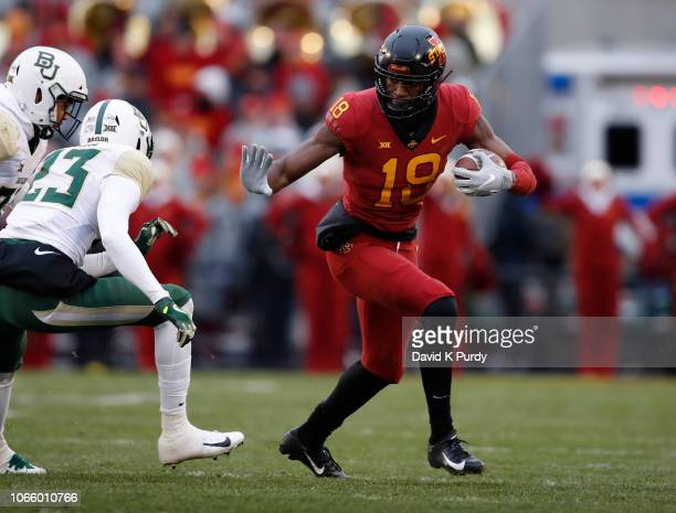 Wide receiver Hakeem Butler of the Iowa State Cyclones rushes for yards as cornerback Derrek Thomas of the Baylor Bears defends in the first half of...