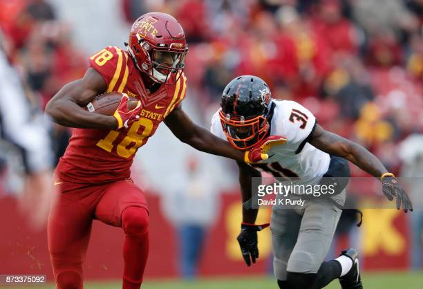 Wide receiver Hakeem Butler of the Iowa State Cyclones rushes for yards past safety Tre Flowers of the Oklahoma State Cowboys in the first half of...