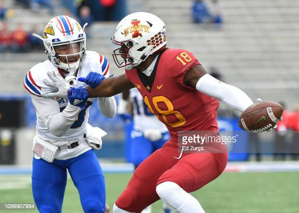 Wide receiver Hakeem Butler of the Iowa State Cyclones slips past cornerback Hasan Defense of the Kansas Jayhawks as goes for a 51yard touchdown pass...