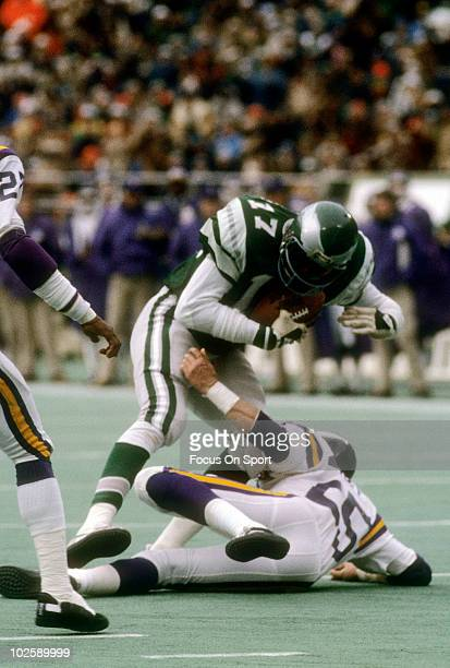 Wide Receiver Harold Carmichael of the Philadelphia Eagles is tackled by defensive back Nate Allen of the Minnesota Vikings October 25 1976 during an...