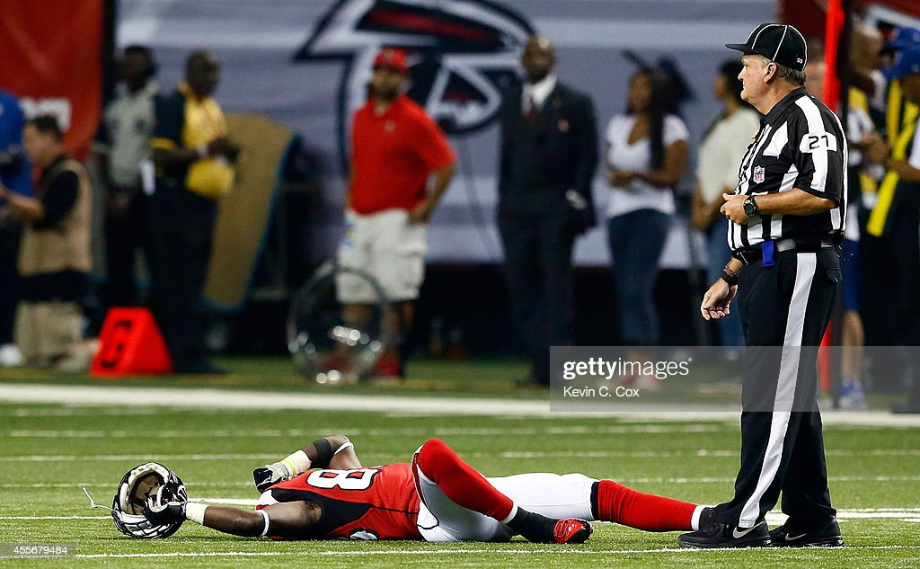 Wide receiver Harry Douglas #83 of the Atlanta Falcons reacts after an injury against the Tampa Bay Buccaneers during a game at the Georgia Dome on September 18, 2014 in Atlanta, Georgia.